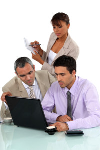 Sales team working on laptop